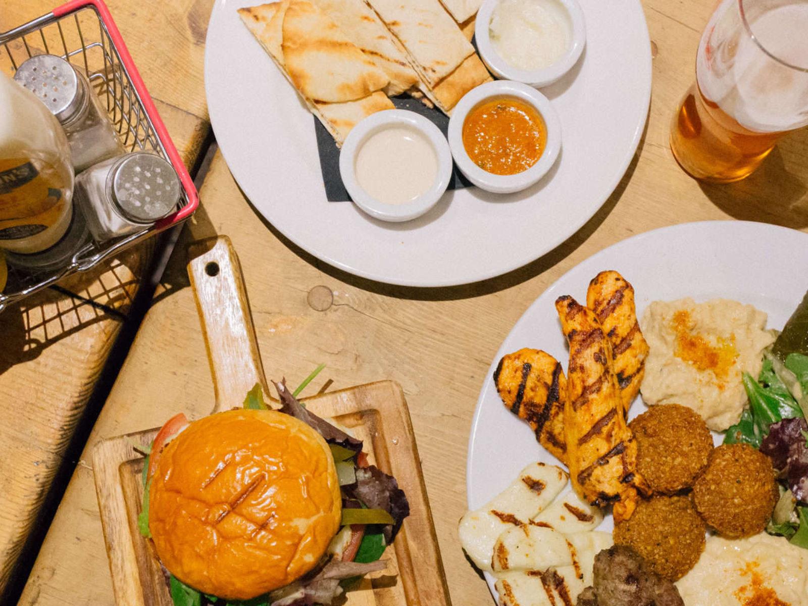 Our homemade burger, pita and mezze platter